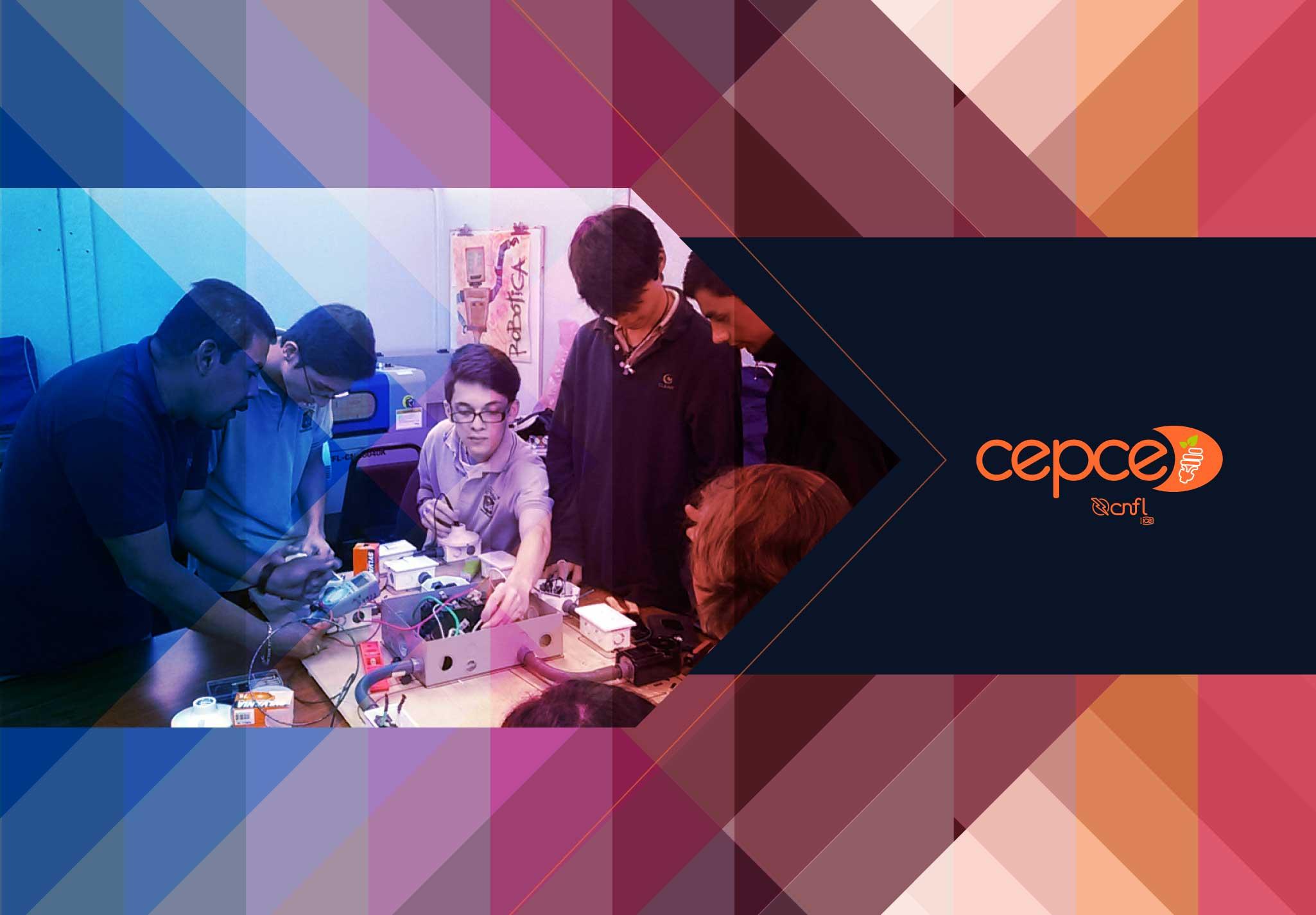 Grupo de estudiantes y un colaborador de la CNFL creando una maqueta que representa las instalaciones eléctricas residenciales